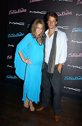 Model NATASHA GILBERT and RYAN KOHN at a party to celebrate Zandra Rhodes's return to London Fashion week and the launch of a limited edition of M.A.C makeup at Silver, 17 Hanover Square, London W1 on 20th September 2006.<br /><br />NON EXCLUSIVE - WORLD RIGHTS