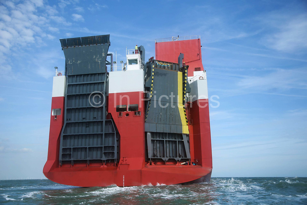 Two Greenpeace climbers scale the back of the cargo ship to prepare to deploy a banner calling for VW to ditch diesel.September 21st 2017, Thames Estuary, Kent, United Kingdom. Greenpeace volunteers in kayaks, speed boats and climbers on the jetty prevent the 23,498-tonne cargo ship Elbe Highway from docking at Sheerness in Kent.  The cargo ship is bringing Volkswagen diesel cars into the UK and the Greenpeace action is to prevent this from happening and to make VW ditch diesel. Two climbers board the ship and hang a banner on the roll-on roll-off part of the ship preventing any cars from being off-loaded. The action is part of a long running Greenpeace campaign to curb diesel emmissions and air pollution brought on by diesel cars.