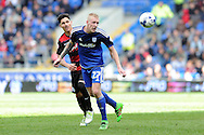 Cardiff City's Lex Immers (27) beats QPR's Alejandro Furling to the ball. Skybet football league championship match, Cardiff city v Queens Park Rangers at the Cardiff city stadium in Cardiff, South Wales on Saturday 16th April 2016.<br /> pic by Carl Robertson, Andrew Orchard sports photography.