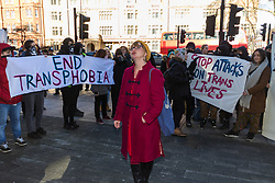 "Anti-transgender feminist Venice Allan, 42, poses in front of transgender rights activists as they demonstrate outside Westminster Magistrates' Court to ""Free the Shewolf"", Tanis Jacob Wolf / aka Tara Flik Wood who is facing a charge of assault by beating of a 60 year old woman at Speaker's Corner in Hyde Park, London in September 2017.<br /> <br /> Wolf/Wood, 26, entered a plea of not guilty and was bailed to appear at Hendon Magistrates' Court in two months' time. London, February 15 2018."