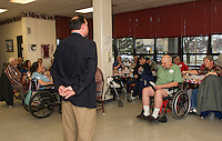 Congressman Frank Guinta answers questions during his visit to the Laconia Housing Authority Sunrise Towers on Thursday afternoon.  (Karen Bobotas/for the Laconia Daily Sun)