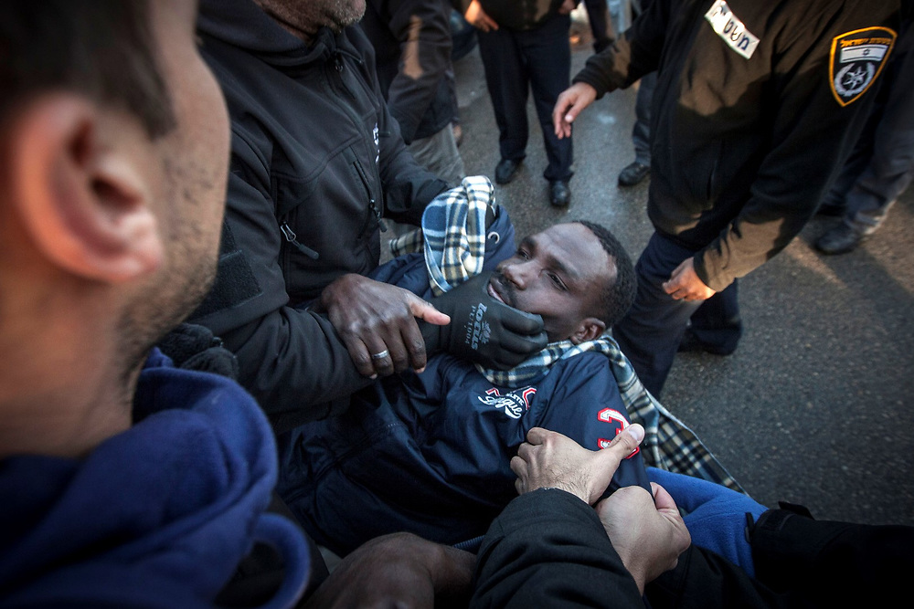 African migrant is arrested by Israeli immigration policemen.<br /> Illegal african migrants and activists protested outside the Israeli parlament in Jerusalem calling to release them and their comads from an open detention center in the south of Israel. The migrants walked for two days from the facility to Jerusalem.