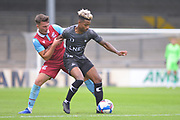 George Hornshaw (44) of Scunthorpe United battles for possession with Jason Lokilo of Doncaster Rovers u23 during the Pre-Season Friendly match between Scunthorpe United and Doncaster Rovers at Glanford Park, Scunthorpe, England on 15 August 2020.