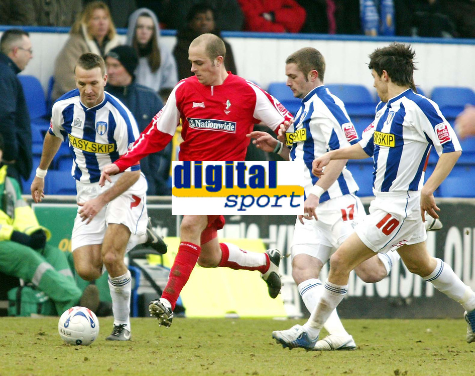 Photo: Chris Ratcliffe.<br />Colchester United v Swindon Town. Coca Cola League 1. 18/03/2006.<br />Jack Smith of Swindon bursts through the Colchester defence of Karl Duguid (L) and John White (2nd R) and Kemi Izzet (far R)
