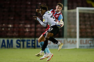 Salford City Brandon Thomas-Asante (37) Scunthorpe United Tyler Cordner (26) battles for possession during the EFL Sky Bet League 2 match between Scunthorpe United and Salford City at the Sands Venue Stadium, Scunthorpe, England on 12 January 2021.
