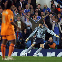 Photo: Paul Thomas.<br /> Chelsea v Barcelona. UEFA Champions League, Group A. 18/10/2006.<br /> <br /> Hilario of Chelsea clears under watch by Ronaldino of Barcelona (L).