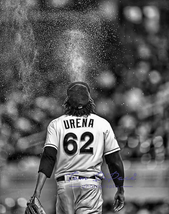 Miami Marlins Jose Urena sprays water during a game.<br /> (Photo byTom DiPace)