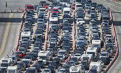 © Licensed to London News Pictures. 28/07/2018. London, UK. Long queues at the port of Dover in Kent as holiday-makers try to get through border control. There are currently wait times of over 2 hours at the approach roads and at border controls. Photo credit: Peter Macdiarmid/LNP
