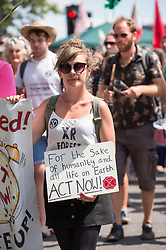 © Licensed to London News Pictures. 16/07/2019; Bristol, UK. Extinction Rebellion Summer Uprising 2019. Extinction Rebellion hold a march to Bristol City City Hall to the Youth XR gathering on College Green where Billy Bragg performed songs. Extinction Rebellion are holding a five-day 'occupation' of Bristol, by occupying Bristol Bridge in the city centre and traffic has to be diverted and carrying out other events. As part of a country-wide rebellion called Summer Uprising, followers will be holding protests in five cities across the UK including Bristol on the theme of water and rising sea levels, which is the group's focus for the South West. The campaign wants the Government to change its recently-set target for zero carbon emissions from 2050 to 2025.<br /> In Bristol Extinction Rebellion plan a week-long occupation of Bristol Bridge in the city centre from Monday and organisers anticipate more than 1,000 people will take part in the action. On Tuesday, they will occupy College Green in front of the city's council house before protesting outside the Ministry of Defence in Stoke Gifford on Friday Photo credit: Simon Chapman/LNP.