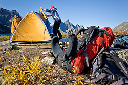 Setting up camp on a hiking trip in Tombstone Territorial Park, Yukon in late summer