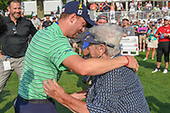 Justin Thomas (USA) receives a big congratulatory hug from his grandmother following 4th round of the World Golf Championships - Bridgestone Invitational, at the Firestone Country Club, Akron, Ohio. 8/5/2018.<br /> Picture: Golffile | Ken Murray<br /> <br /> <br /> All photo usage must carry mandatory copyright credit (© Golffile | Ken Murray)