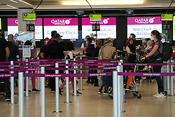 © Licensed to London News Pictures. 16/07/2021. Edinburgh, Scotland, UK. Passengers wait at check-in desks in the departures hall at Edinburgh Airport. The Scottish government has announced that from 19 July, fully vaccinated UK residents and all children will be able to travel to amber list countries without needing to quarantine when re-entering the country. Photo credit: Dinendra Haria/LNP