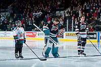 KELOWNA, CANADA - DECEMBER 2: The Pepsi Save On Foods player of the game lines up with Jackson Whistle #1 and Joe Gatenby of the Kelowna Rockets against the Kootenay Ice on December 2, 2015 at Prospera Place in Kelowna, British Columbia, Canada.  (Photo by Marissa Baecker/Shoot the Breeze)  *** Local Caption *** Pepsi Save On Foods player; Jackson Whistle; Joe Gatenby;