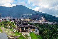 Indonesia, Java, Parompong. Tangkuban Prahu volcano. The inevitable souvenir stalls on the crater rim.