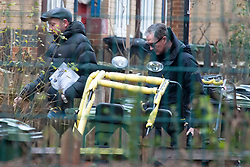 © Licensed to London News Pictures. 23/01/2019. West Norwood, UK. Police officers believed to be from Gang Crime Command (from paper work they are holding) inside the police inner cordon.A fifteen year old boy has been shot in West Norwood and is believed to be in a critical condition in hospital, Police are at the scene and are standing guard at cordons.Photo credit: Grant Falvey/LNP