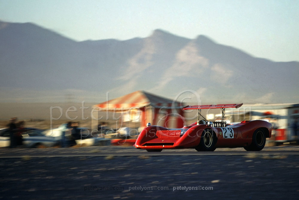 Chris Amon in Ferrari 612P making its debut in the Can-Am at Las Vegas in 1968. Note air-brake atop front body is being actuated; wing atop roll bar is also driver-controlled. This photo was made in practice. The car was eliminated from the race in a first-turn accident.