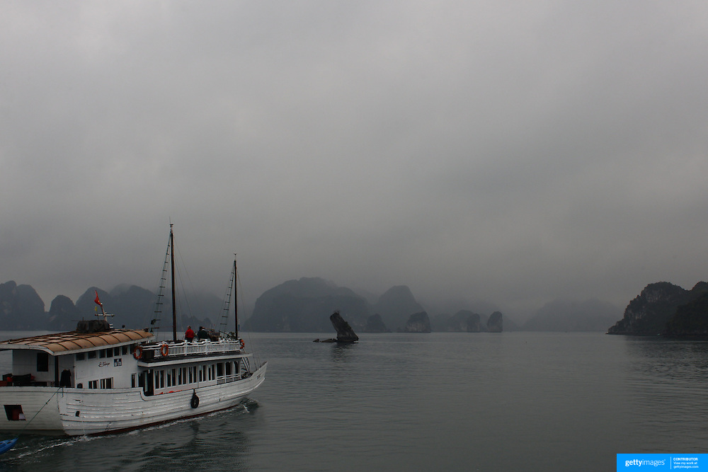 A tourist Junk sailing in Ha Long Bay, Vietnam. The bay consists of a dense cluster of 1,969 limestone monolithic islands. Ha Long Bay, is a UNESCO World Heritage Site, and a popular tourist destination. Ha Long, Bay, Vietnam. 11th March 2012. Photo Tim Clayton