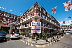 © Licensed to London News Pictures. 10/06/2021. London, UK. England flags fly from residential flats on the Kirby Estate in Bermondsey, East London. The UEFA EURO 2020 soccer tournament was delayed by a year because of the Covid-19 pandemic and will now take place from 11 June 2021. Photo credit: Ray Tang/LNP
