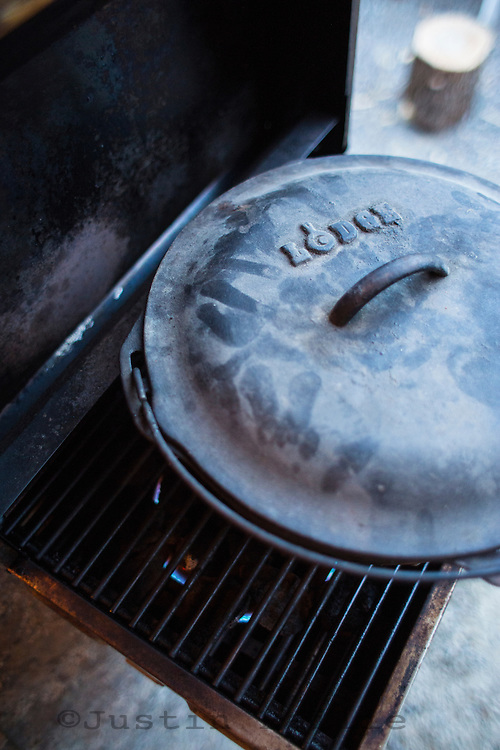 Cast iron dutch oven on camp stove.