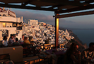 Dining at sunset in Fira on the island of Santorini.  Photograph by Dennis Brack
