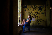 In this Sept. 10, 2017 photo, Elen, 18, poses for a photo inside the building that used to house the Brazilian Institute of Geography and Statistics, in the Mangueira slum, Rio de Janeiro, Brazil. (AP Photo/Felipe Dana)