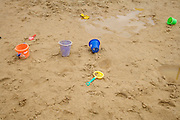 children toys outside on a wet rainy day