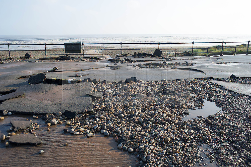 © Licensed to London News Pictures. 07/09/2013<br /> <br /> Saltburn, Cleveland, England<br /> <br /> Tarmac is ripped up on the lower promenade following an evening of torrential rainfall that caused flooding and disruption to Saltburn in Cleveland.<br /> <br /> Photo credit : Ian Forsyth/LNP