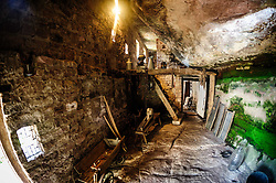 Interior of a workshop in a troglodyte dwelling in the village of Graufthal, Alsace, France.  The houses are built into the cliffs with the rock forming the ceiling and floor.  Dating back several centuries, the houses were inhabited until 1958 and are now a historical monument.<br /> <br /> (c) Andrew Wilson   Edinburgh Elite media