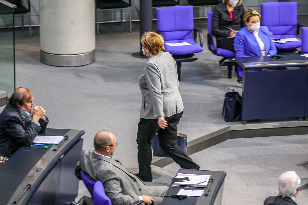 German Chancellor Angela Merkel attends a bundestag session dealing with the coronavirus vaccination operation in Germnay at the Bundestag in Berlin, Germany, January 13, 2021.