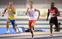 Poland's Remigiusz Olszewski (centre), Sweden's Henrik Larsson, and Turkey's Emre Zafer Barnes (right) during the final heat of the men's 60m semi final during day two of the European Indoor Athletics Championships at the Emirates Arena, Glasgow.