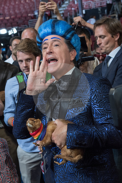Comedian Stephen Colbert, shouts to the stage dressed in costume during the filming of a skit on the floor of the Democratic National Convention July 24, 2016 in Philadelphia, Pennsylvania. Colbert appeared dressed as Caesar Flickerman from the Hunger Games and continues the act from last weeks Republican Convention.