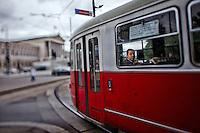 View of a man on a tram, Vienna, Austria.