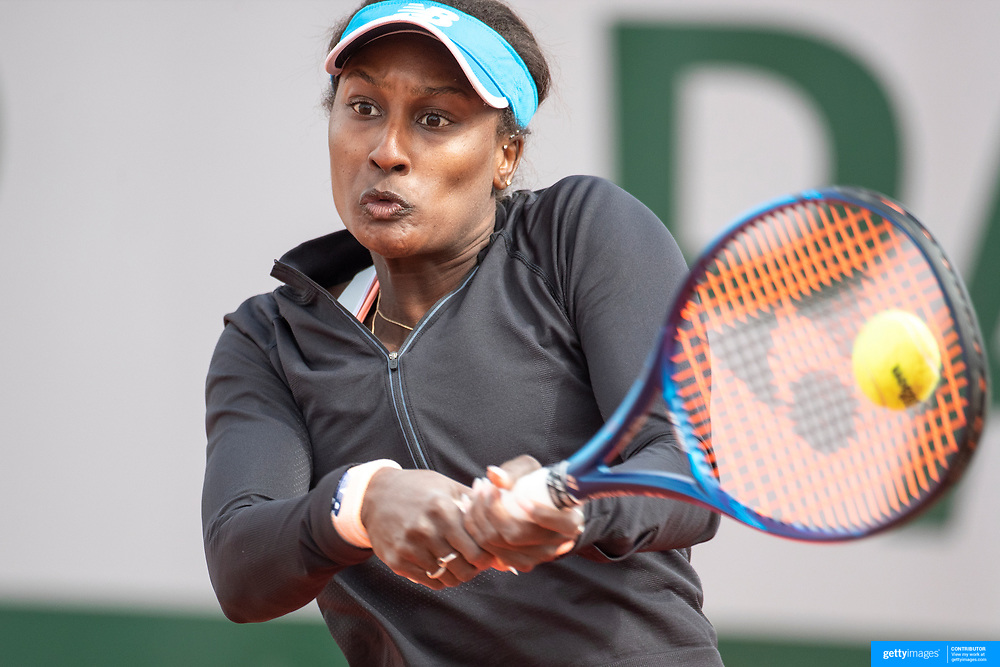 PARIS, FRANCE May 25.  Asia Muhammad of the United States in action against Whitney Osuigwe of the United States on the second day of the qualifying tournament at the 2021 French Open Tennis Tournament at Roland Garros on May 25th 2021 in Paris, France. (Photo by Tim Clayton/Corbis via Getty Images)