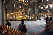 men praying in the Yeni Camii in Istanbul