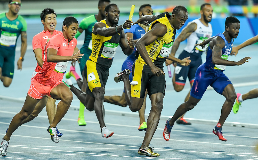 Jamaica's Usain Bolt took the baton on the last leg of the men's 4X100 relay final from teammate Nickel Ashmeade for the gold medal on Friday at Olympic Stadium during the 2016 Summer Olympics Games in Rio de Janeiro, Brazil.