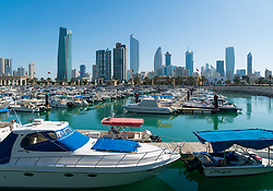Skyline of modern office towers in downtown CBD of Kuwait City from Souq Sharq marina in Kuwait