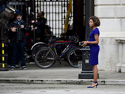 "© Licensed to London News Pictures. 30/05/2015. London, UK. Actress Naomie Harris (right) and director Sam Mendes (left). Filming for the new James Bond film ""Spector"" with Daniel Craig and Naomie Harris at the courtyard of the UK Government Treasury building in Westminster, London . Photo credit: Ben Cawthra/LNP"