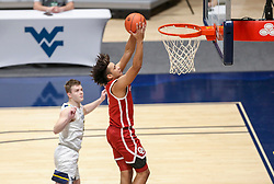 Feb 13, 2021; Morgantown, West Virginia, USA; Oklahoma Sooners forward Jalen Hill (1) dunks the ball during the first half against the West Virginia Mountaineers at WVU Coliseum. Mandatory Credit: Ben Queen-USA TODAY Sports