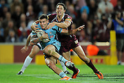 May 25th 2011: Billy Slater of the Maroons tackles  Josh Dugan of the Blues during game 1 of the 2011 State of Origin series at Suncorp Stadium in Brisbane, Australia on May 25, 2011. Photo by Matt Roberts/mattrIMAGES.com.au / QRL