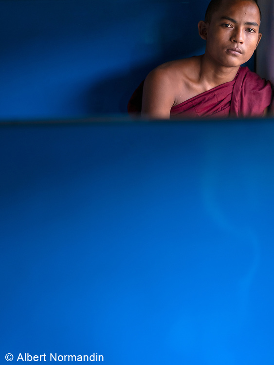 Traveling Monk, 17 year old Monk on train, Yangon, Rangoon, Myanmar