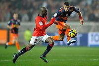 FOOTBALL - FRENCH CHAMPIONSHIP 2010/2011 - L1 - PARIS SAINT GERMAIN v MONTPELLIER HSC - 13/03/2011 - PHOTO GUY JEFFROY / DPPI - YOUNES BELHANDA (MON) / CLAUDE MAKELELE (PSG)