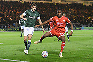Bez Lubala (30) of Crawley Town battles for possession with Scott Wootton (5) of Plymouth Argyle during the EFL Sky Bet League 2 match between Plymouth Argyle and Crawley Town at Home Park, Plymouth, England on 28 January 2020.