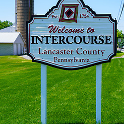 Intercourse, PA, USA - May 15, 2019: The Welcome to Intercourse sign on the edge of the small village, popular among tourists in rural Lancaster County's Amish area.
