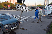 Moscow, Russia 13/05/2007..A member of an ambulance crew helps a drunken driver from his car after he crashed into a stop sign at at a road junction. The man was uninjured but was so drunk he could not walk without assistance.