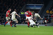 George North of Wales is stopped by Ben Te'o and Maro Itoje ® of England. England v Wales, NatWest 6 nations 2018 championship match at Twickenham Stadium in Middlesex, England on Saturday 10th February 2018.<br /> pic by Andrew Orchard, Andrew Orchard sports photography