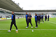 AFC Wimbledon players on the pitch on arrival at Home Perk stadium before the EFL Sky Bet League 1 match between Plymouth Argyle and AFC Wimbledon at Home Park, Plymouth, England on 6 October 2018.