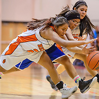 Gallup JV Bengals Kamaryn Yazzie (22) and Paige Juan (13) dive after the ball with Navajo Pine Warrior Cheynay Castillo (20) Thursday at Wingate High School.