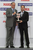 Referee Mateu Lahoz receives the Best Referee award during the MARCA Football Awards ceremony in Madrid, Spain. November 10, 2014. (ALTERPHOTOS/Victor Blanco)