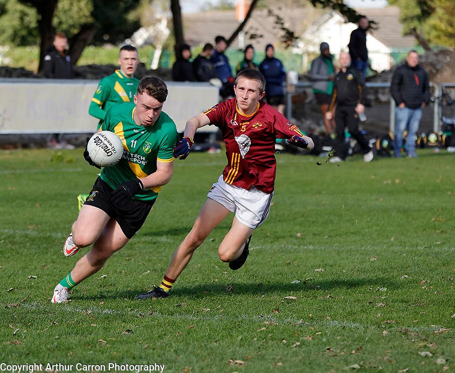 3/10/21 Thomas Davis player Sean Dignam in action against St Oliver Plunkett's Scott Couch in their Dublin MFC B game in Kiltipper. Pictures: Arthur Carron