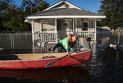 Delores Miller boards a canoe after checking on her elderly mother's home in downtown Lumberton, NC, USA,, after Hurricane Matthew caused downed trees, power outages and massive flooding along the Lumber River, on Tuesday, October 11, 2016. Photo by Travis Long/Raleigh News & Observer/TNS/ABACAPRESS.COM